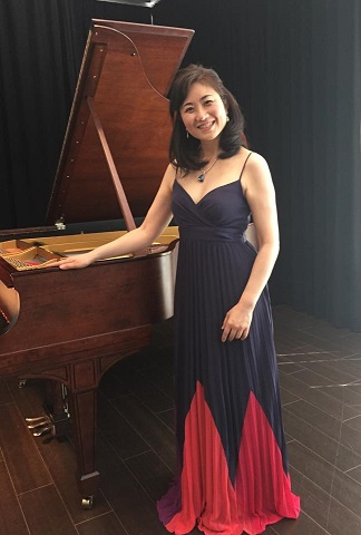 lunchtime concert posing with the piano
