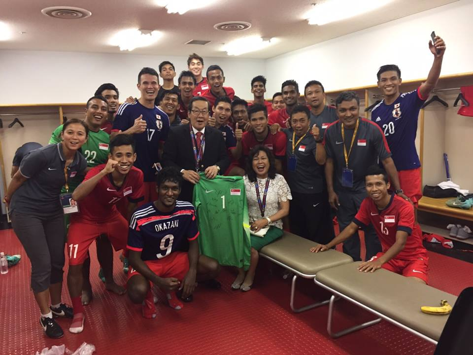 The Lions celebrating with Mr Chin Siat Yoon